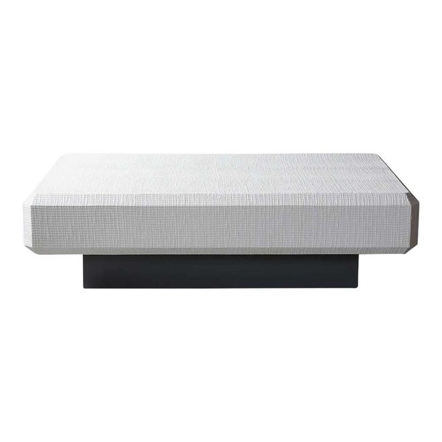 This Karl Springer Floating grasscloth coffee table is in great condition and has a large rectangular top covered in...