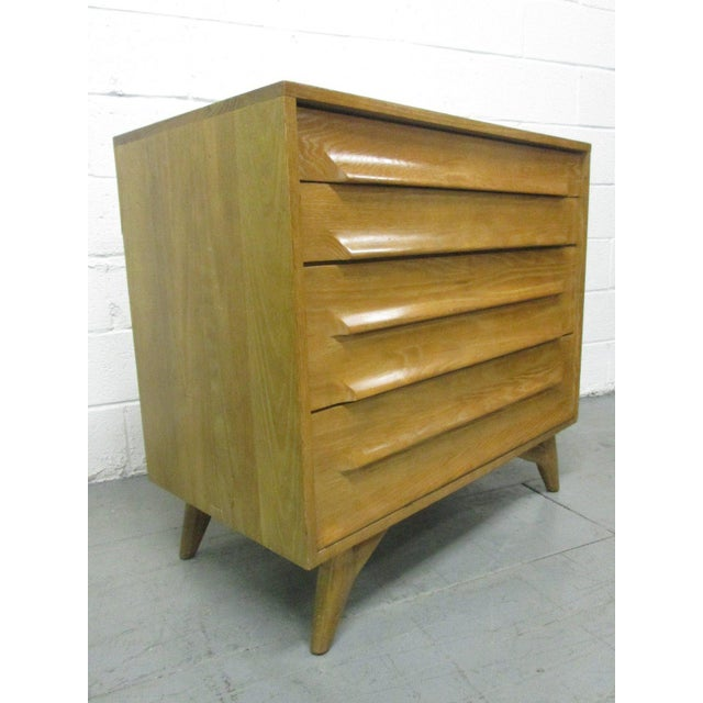 Pair of Cerused oak chests. Has four pull-out drawers. The first drawer in each chest has a pull-out writing surface.