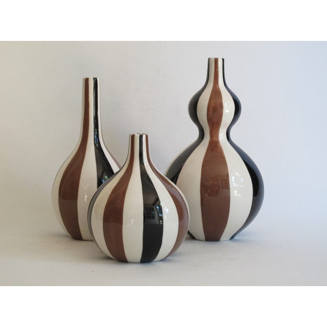 "Striped vase trio from the Jonathan Adler Happy Home Collection. Marked on the bottom of each. Large: 9""H, Medium: 7""H,..."
