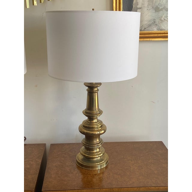 Pair of beautiful Stiffel heavy brass lamps with perfect white Shadow Shade. (16 Round X 10.5 H). Very clean and would be...