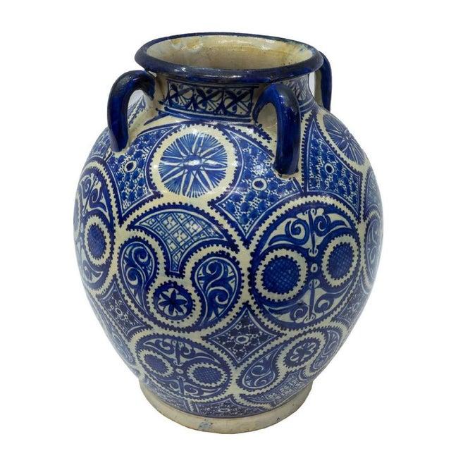 Moroccan ceramic jar, 20th c. A stunning blue and white ceramic. Features Hispano-Moorish style arabesque design in blue...