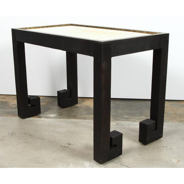 Greek Key tables in distressed wood with black finish and top edges in mottled gold. Unlacquered brass inset. See last two...