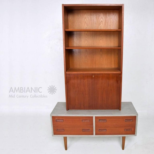 For your consideration a Danish modern cabinet with four pull-out drawers and hutch. The cabinet is two-tone, teak with...