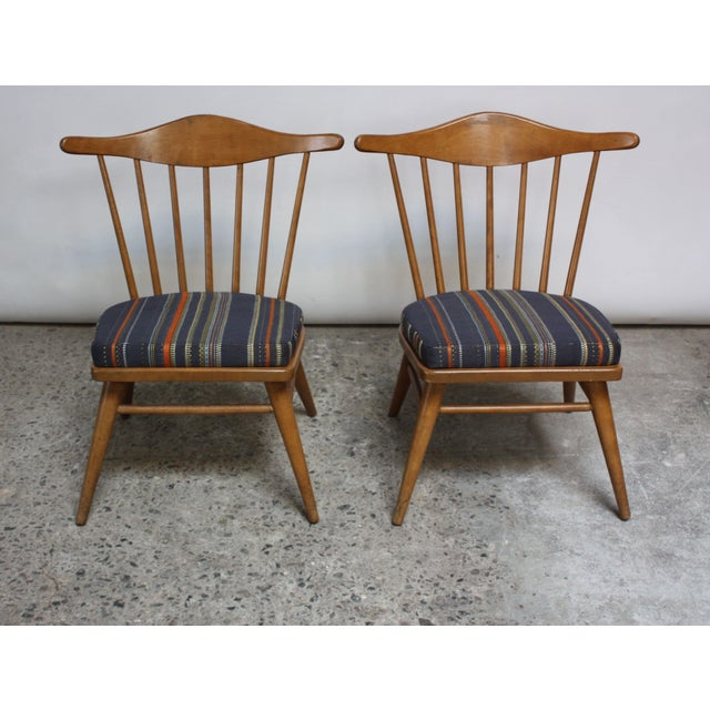 This pair of low, solid maple Conant Ball side chairs is attributed to Russel Wright, who designed for the company...