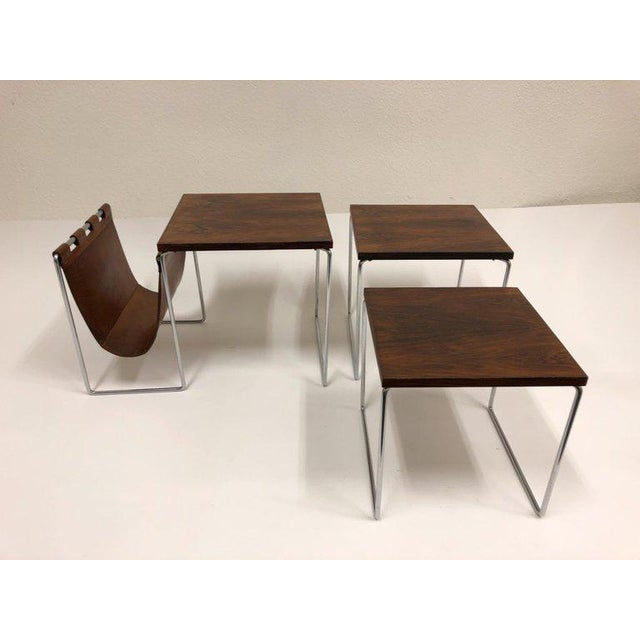 A beautiful set of three rosewood and chrome with a saddle leather magazine holder. This are in beautiful original...