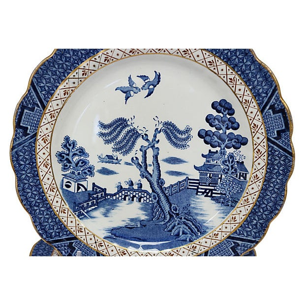 Set of 12 English salad plates in the Real Old Willow pattern. Maker's mark on underside.
