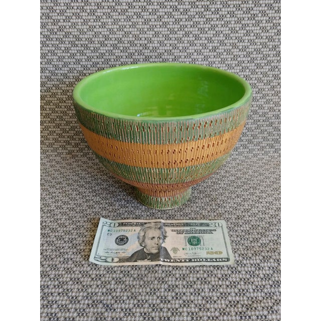 "A circa 1950's Italian footed bowl with green and gold glazes. Heavily incised surface decoration. 8"" in diameter and 6..."