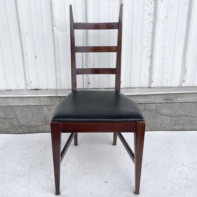 This high back walnut dining chair features stylish mid-century modern design with tapered wood frames and upholstered...