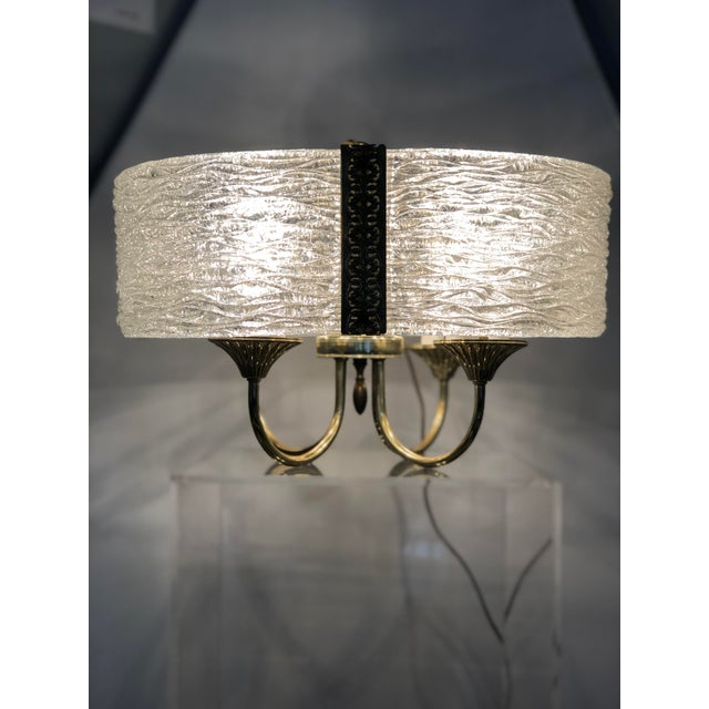 Mid Century Modern cut glass chandelier with an unusual four leaf clover shape. The details in this chandelier make it...