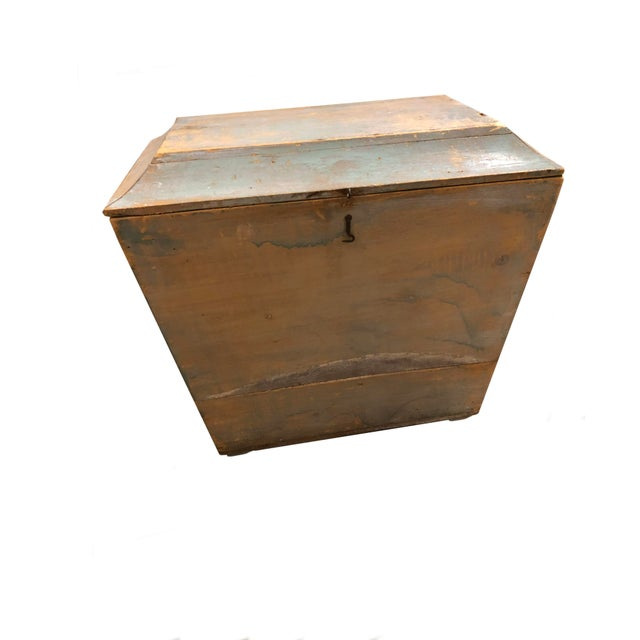 An antique wooden storage box with original paint and a hinged top. From Switzerland, circa 1900.