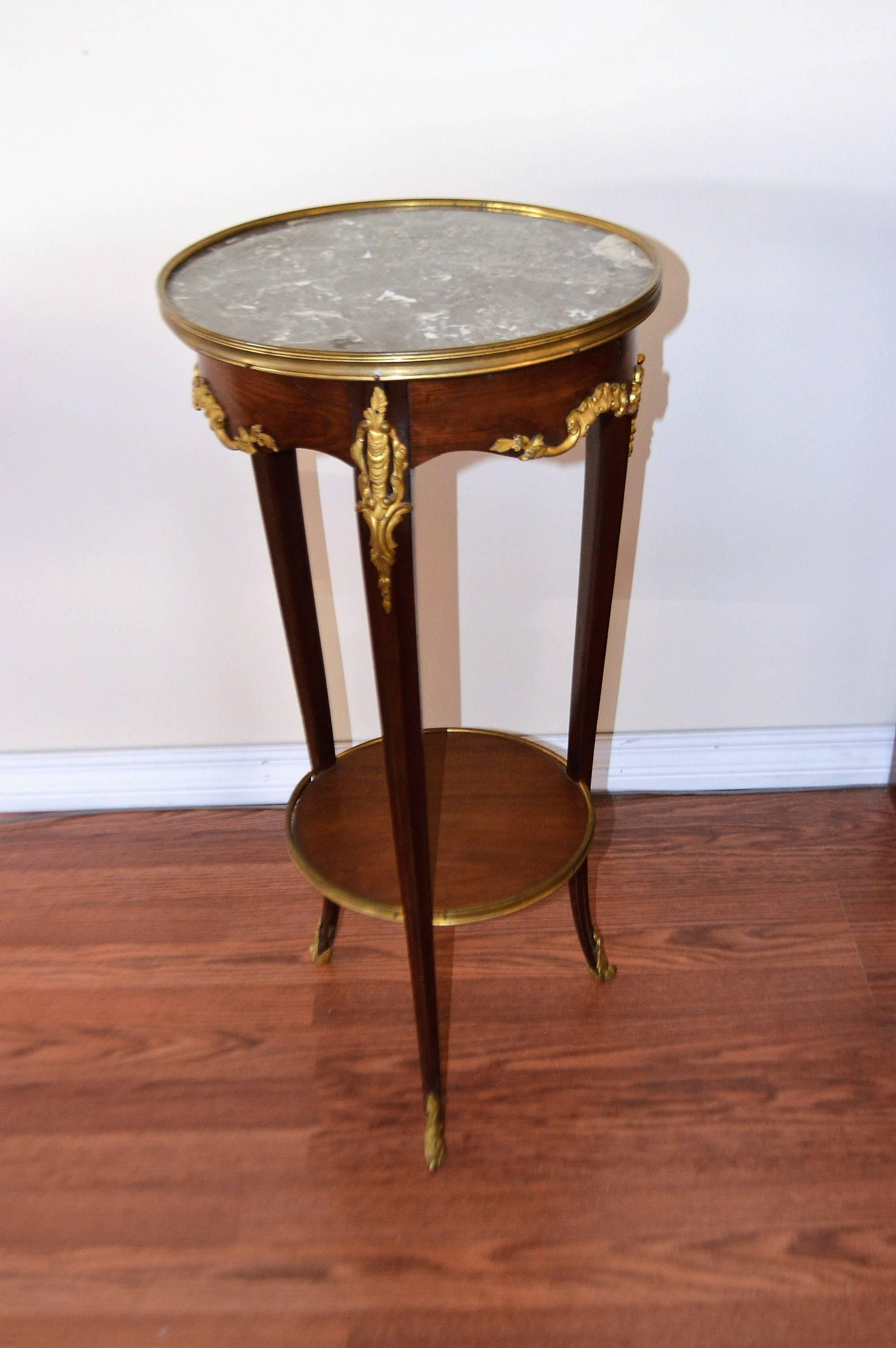 Charming, Three Leg Round Side Table With Bronze Accent Details On Each Leg  As