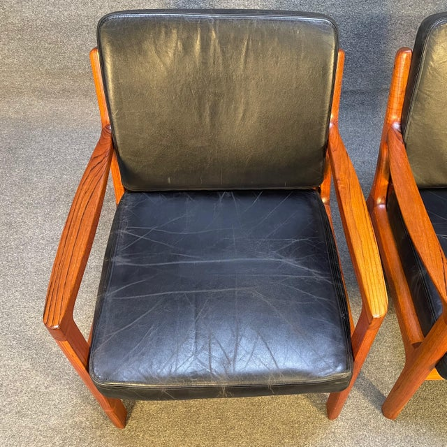 """Here is an exquisite set of two Scandinavian modern """"Senator"""" easy chairs in solid teak designed by Ole Wanscher and..."""
