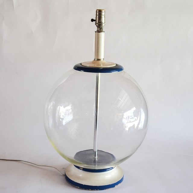 A vintage clear glass fishbowl shaped table lamp attribute to Murano Glass from the 1970's. This lamp has brass hardware,...