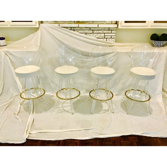 Gorgeous set of 4 vintage lucite fan back bar stools! Super thick and heavy duty lucite frame with white leather seats!...