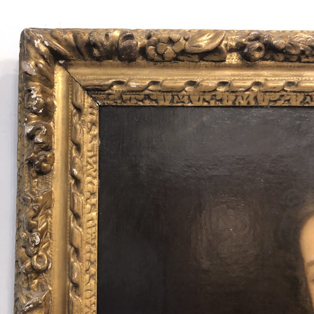 18th Century oil on board portraiture painting of pale noble woman, framed in carved gilt wood. Measures at 31 inches...