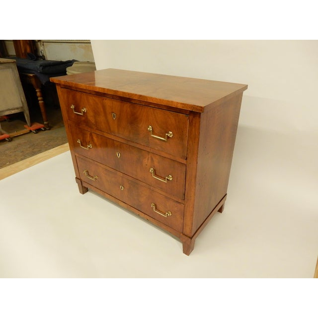 Very nice early 19th century French walnut three drawer commode. Bought in the South of France, it has lovely warm rich...