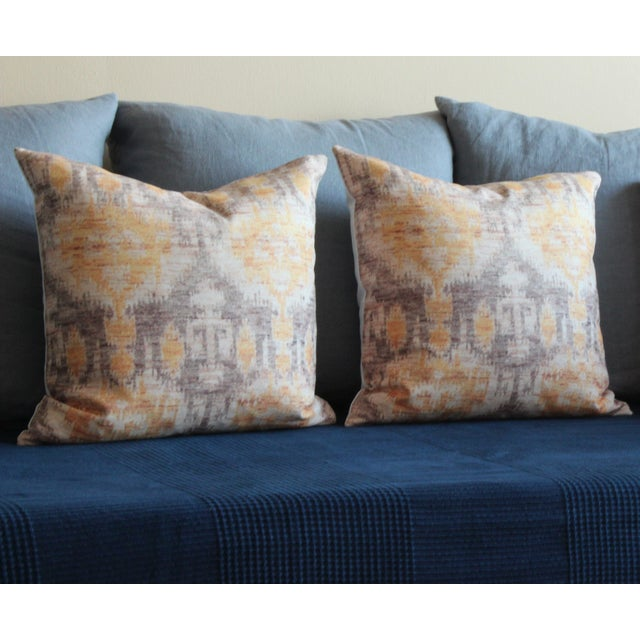 """A pair of 16x16"""" yellow vintage ikat print pillows. Warm up your place with these lovely pillow covers, printed on..."""