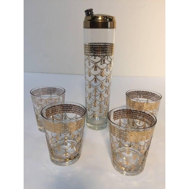 Elegant vintage cocktail set of midcentury barware glasses with 22-karat gold leaf design. Includes four large cocktail...