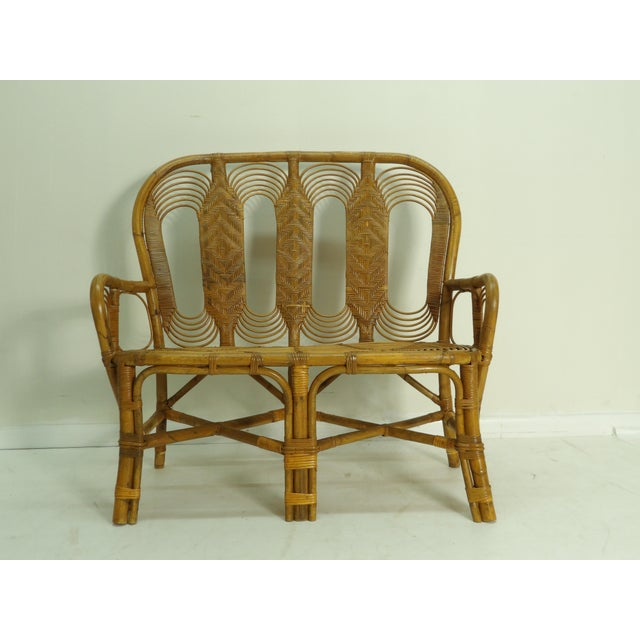 Exceptional Design, Craftsmanship and Style make this Rattan Settee unique . The Settee has a decorative back, features...