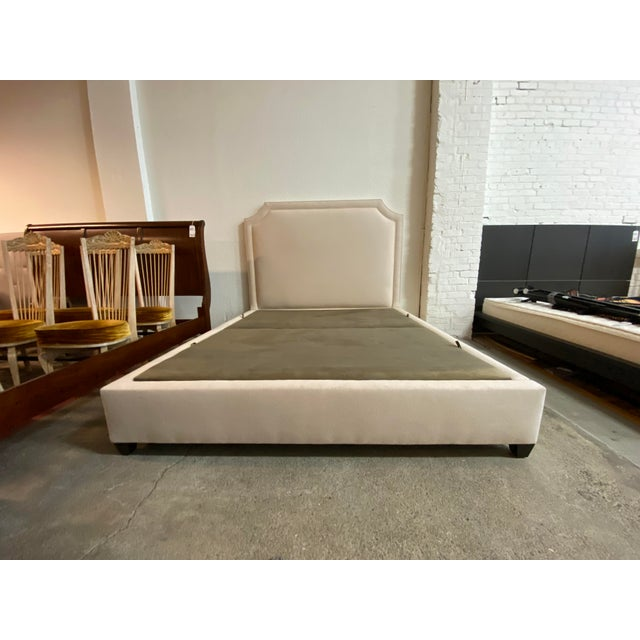 Design Plus Gallery presents a California King Upholstered Headboard by Nathan Anthony. Visible wear on the fabric, good...