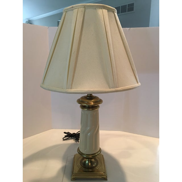 Lovely traditional Stiffel and Lenox brass table lamp . Comes with original pleated silk shade Stiffel labeling socket ....