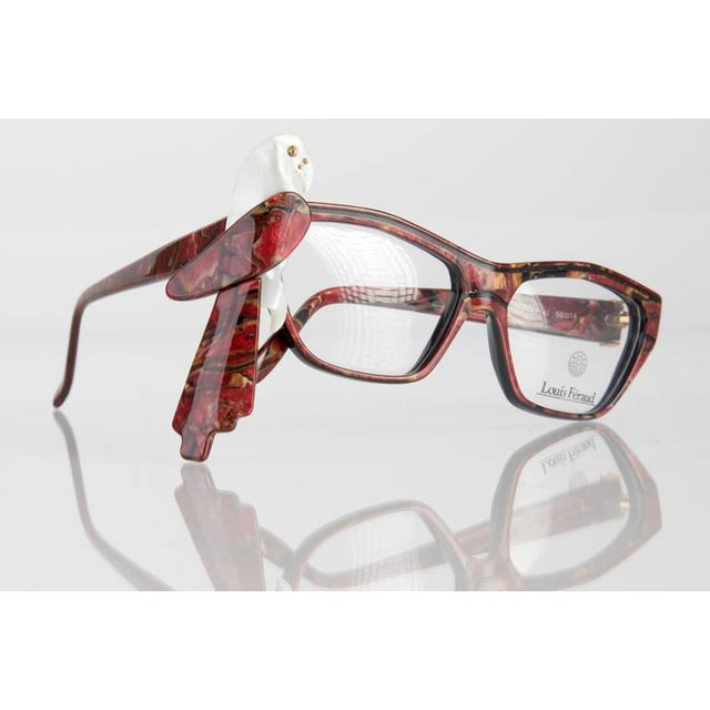 Collectable, Louis Feraud Parrot Glasses Frames. These frames are in a Marble Burgundy color and have a modified cat eye...