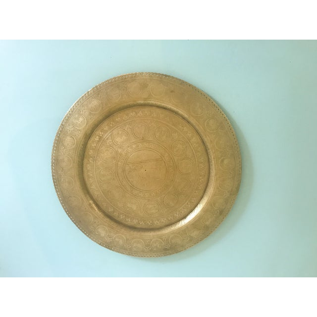 Unique brass plate engraved with the Zodiac symbols. Gorgeous detail with a pretty scallop + dot border. Great find! Brass...