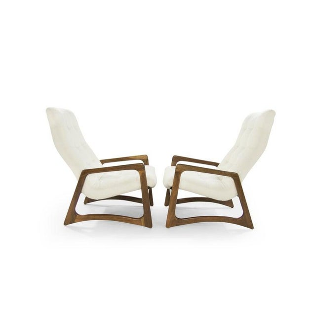 Pair of lounge chairs designed by Adrian Pearsall, circa 1950s. Sculptural walnut framing fully restored, newly...