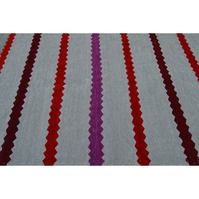Handwoven Moroccan Berber kilim with intricate striped pattern.