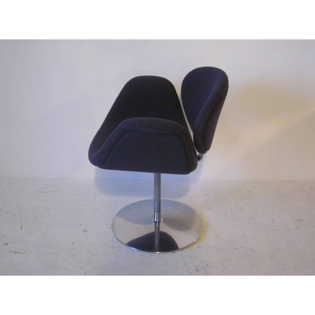 A sculptural Op Art Pierre Paulin armchair in a gray blue contract fabric with swiveling chromed aluminum base and painted...
