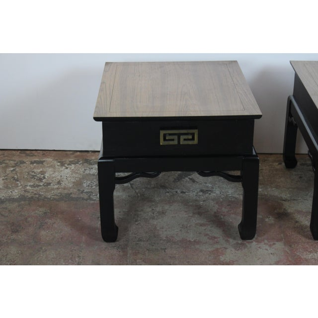 Pair of Asian style end tables or night stands. It has a single drawer with brass handles.