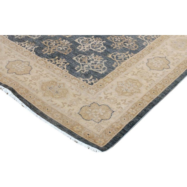 The cultured look of antiquity is exhibited in this mesmerizing hand knotted rug which has been made with the finest...
