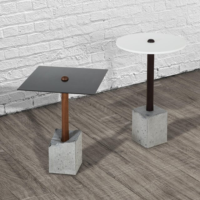 This simple and elegant design is composed of a hand-turned upright piece of wood that is cast into a concrete base. Shown...