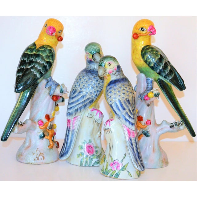 This is a beautiful set of four majolica parakeets in a Chinese Export style detail. One pair has deep emerald green...