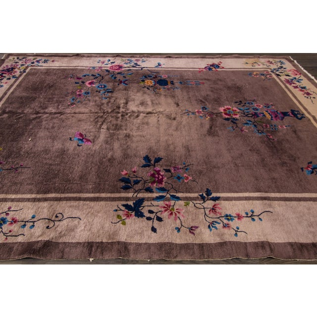 Vintage hand-knotted Chinese Peking rug with a floral design on a gray field. This rug has a great color scheme and very...