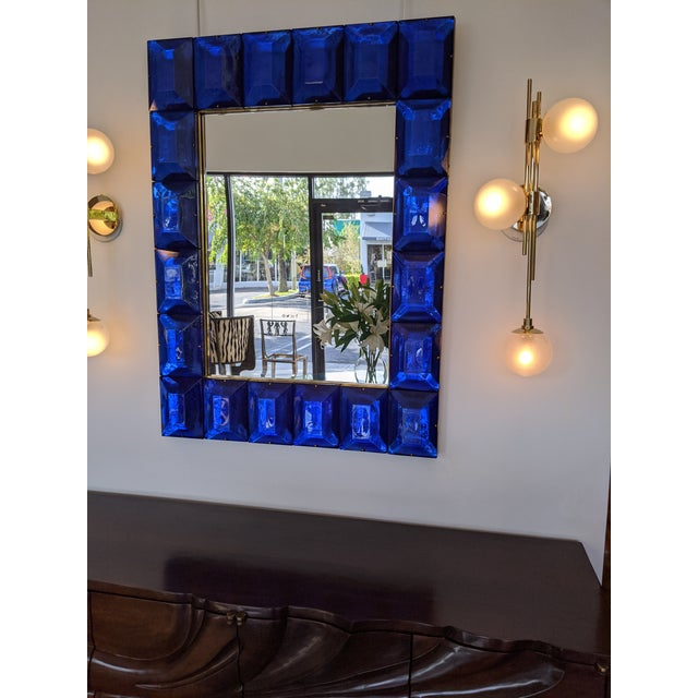Customizable Faceted Murano glass mirror in Cobalt Blue Contemporary and customizable mirror with a faceted Murano glass...