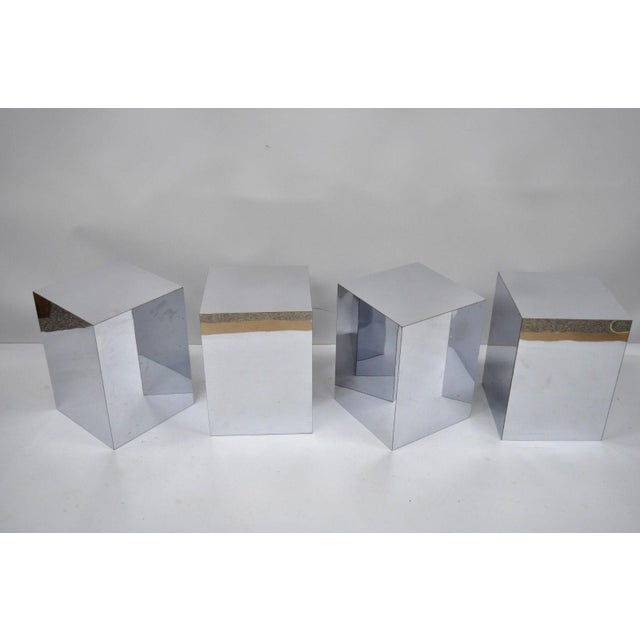 Vintage 1970s mirrored metal laminate cube pedestal side table. Price is per pedestal. Item features mirrored metal...