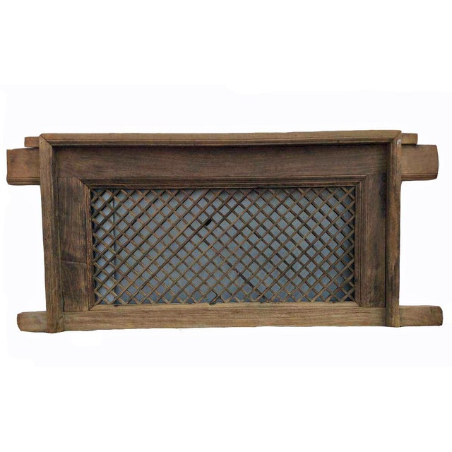 Made of elm, this wood screen window is over 150 years old. It is in its original wood color and with frame. An intriguing...
