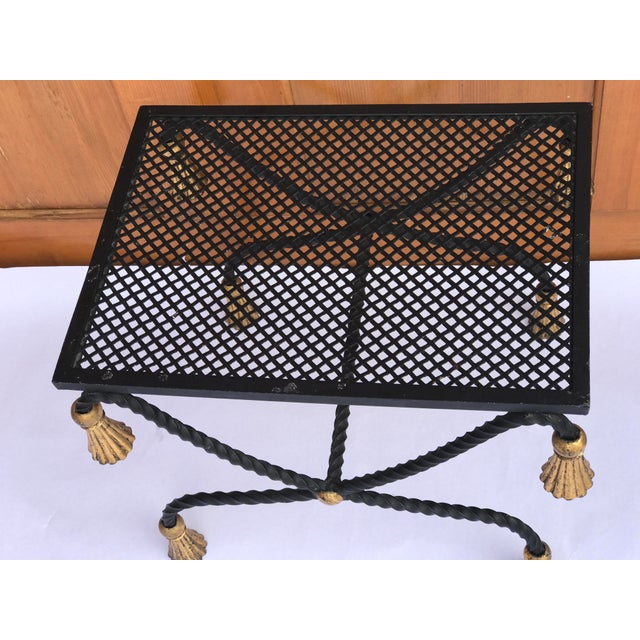 Black iron Hollywood Regency Italian Metal X Bench with gilded Rope detail and tassels.