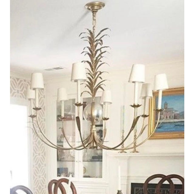 e.f. Chapman for Visual Comfort 8-arm Gramercy Chandelier with gilded iron finish, antiqued mirror sphere center, and...