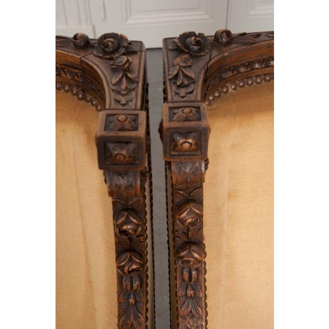 French 19th Century Louis XVI Carved Walnut Bergères - a Pair For Sale - Image 4 of 12