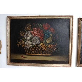 A Still Life Painting of a Basket of Flowers Preview