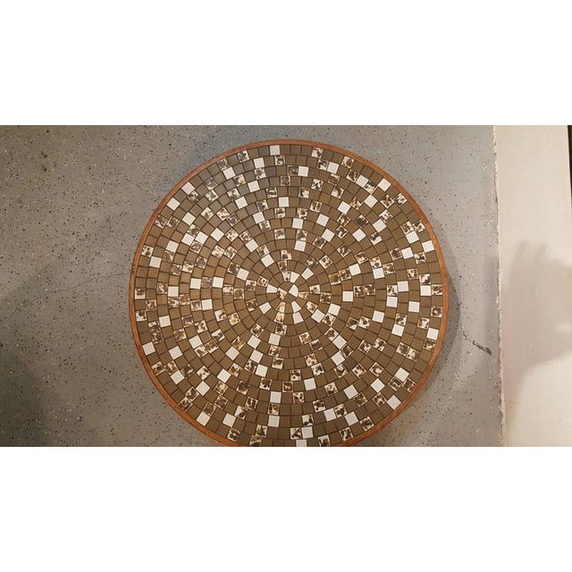 A Gordon & Jane Martz circular mosaic tile coffee table for Marshall Studios, circa 1960s. Solid walnut frame and conical...