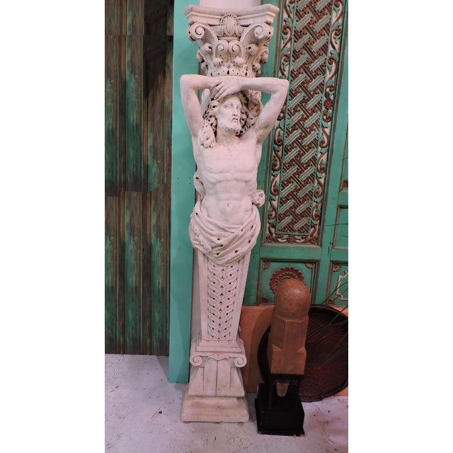 A pair of highly figurative and expressive handcarved limestone male caryatids. Ideal for a home entryway, outdoor garden...
