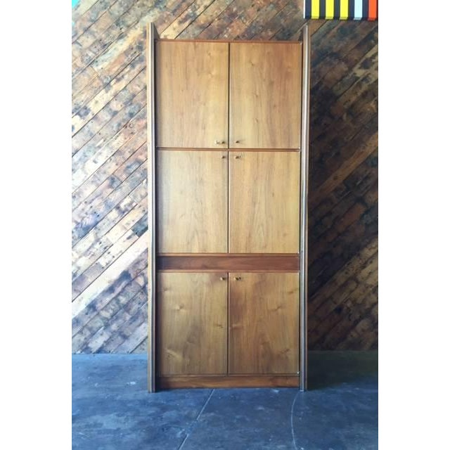 Mid-century 1960s tall walnut cabinet with stainless trim and beautiful grain. Lock door feature with key, plenty of...