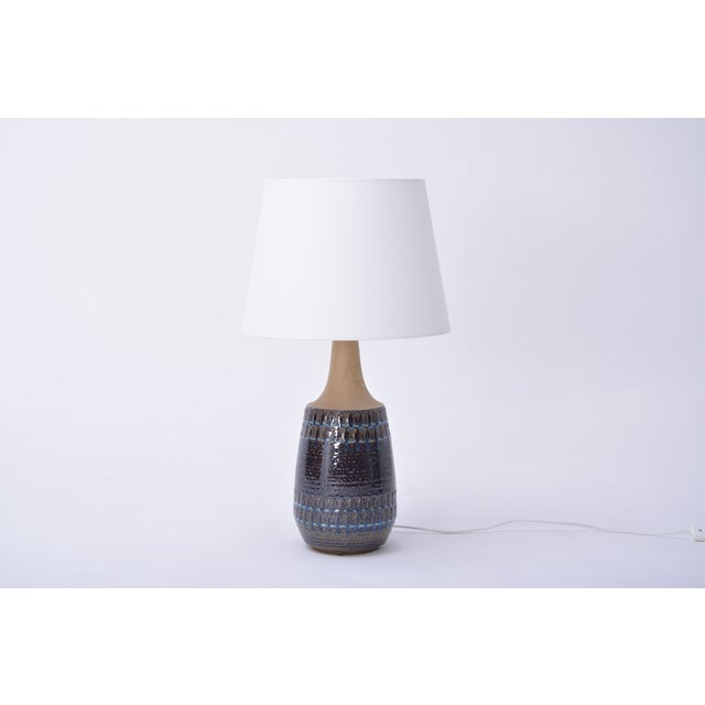 This large table lamp was produced by Danish company Soholm Stentoj in the 1970s. It is made of stoneware and features a...