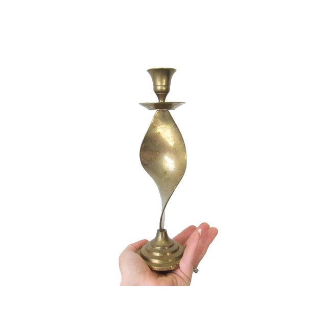 This listing is for three vintage brass candle holders, which are the perfect little addition to your classic decor. Each...