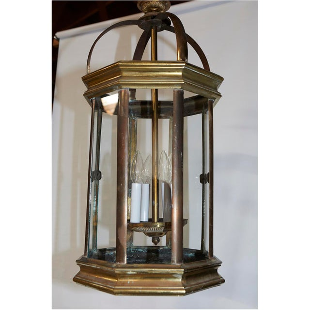 This pair of original English lanterns were gas lamps converted to electricity with four candle stick lights. They are...