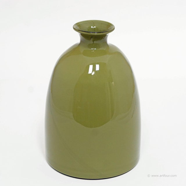 a colorful green glass vase manufactured by the muranese glassmakers of gino cenedese in the 60ties. original company...