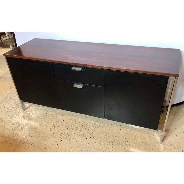 Mid-Century Modern chrome rosewood and ebony file cabinet or server by Milo Baughman. This fine rosewood cabinet was hand...